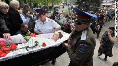 Cossacks carry a coffin into a church in Slaviansk, Ukraine, on Tuesday, April 22, during a funeral ceremony for men killed in a gunfight at a checkpoint two days before.