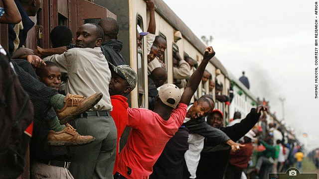 Passengers ride an overloaded commuter train at the Makadara station in Kenya's capital Nairobi. The larger-than-normal numbers were due to a strike by minibus drivers and conductors.
