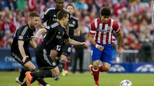Atletico Madrid dangerman Costa is surrounded by Chelsea defenders as he attempts to attack the visiting goal.