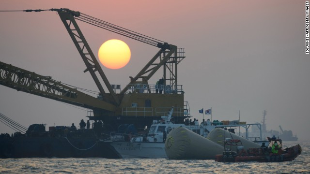 The sun sets over the site of the sunken ferry off the coast of the South Korean island of Jindo on April 22.