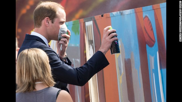 Prince William uses a spray canister during a visit to a skate park on April 23.