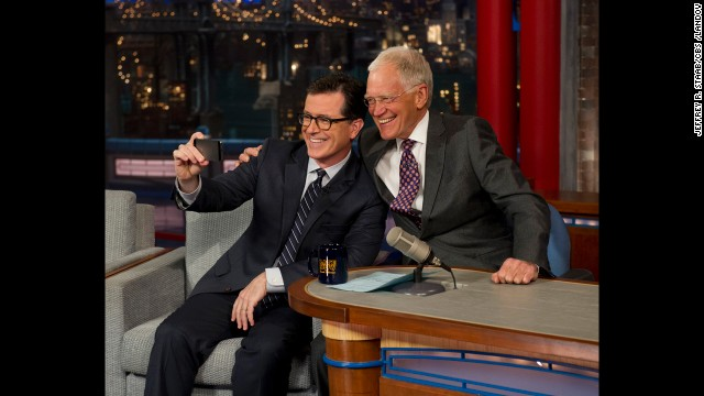 "Colbert takes a selfie with Letterman on the ""Late Show with David Letterman"" on Tuesday, April 22. CBS began to introduce the next host of the ""Late Show"" by having its current host interview him."