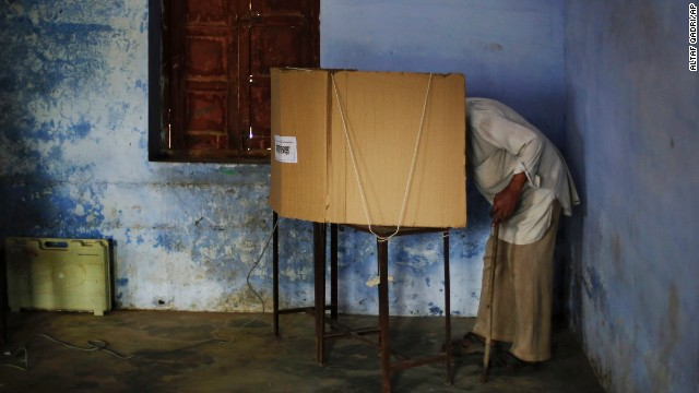 An elderly man casts his vote inside a polling station in Amroha, India, on April 17.