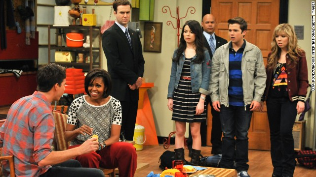 "Obama, second from left, speaks to Jerry Trainor during a special appearance on Nickelodeon's series ""iCarly"" on June 13, 2011."