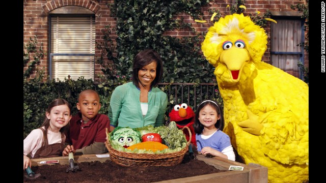 "The first lady joins the Sesame Street gang in ""Michelle Obama Plants A Garden"" in Astoria, New York, on May 5, 2009."