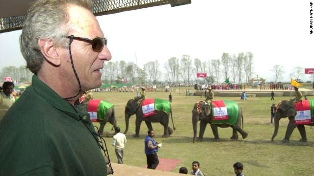 Shand, brand ambassador for Kaziranga National Park, watches as elephants parade during the park's centenary celebration in Kaziranga, India, on February 12, 2005.