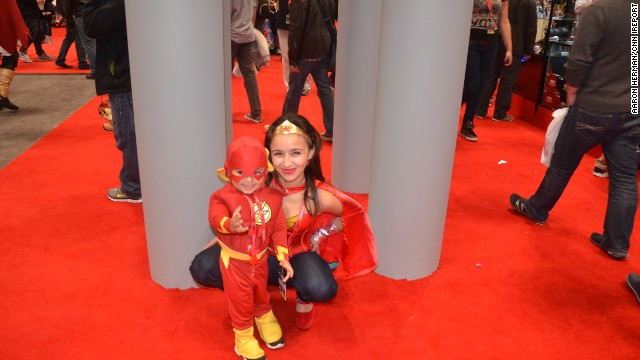 Kids can often be seen dressing like their adult cosplaying counterparts at conventions like <a href='http://ireport.cnn.com/docs/DOC-1047486'>New York Comic Con</a>. Here's Wonder Woman posing with a pint-size Flash at last year's convention in the Big Apple.