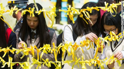 South Korean ferry disaster: Solemn reopening for school at center of tragedy