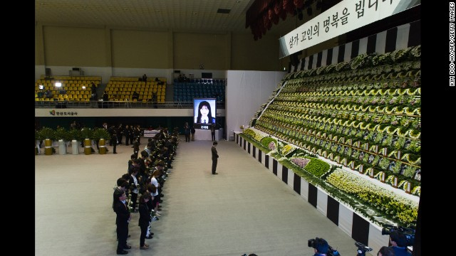 People attend a memorial for the victims at Olympic Memorial Hall in Ansan.