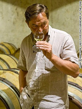 Dominique Lafon, managing director of the Comtes Lafon vineyard estate in eastern France, tastes wine in his cellars in this image by John Wyand. The image took first prize in the Errazuriz Wine Photographer of the Year -- People category.