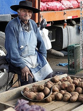 A potato seller in Chile is shown in this image from photographer Emma Wood. Her image won the Food for Sale category.