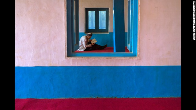 A man reads at a mosque in Bamiyan, 2006.