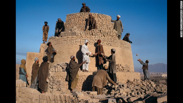 Men work to rebuild a damaged kiln in Kandahar, 1992.