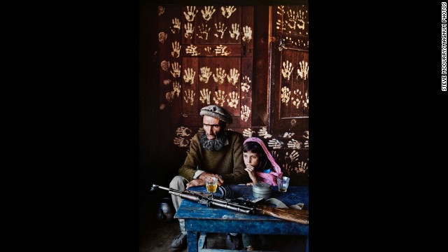 A father and daughter at home in Kamdesh, 1992.