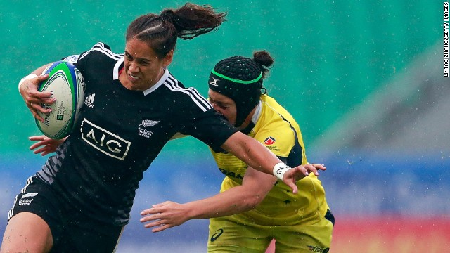 McAlister tries to evade a tackle by Emilee Cherry during New Zealand's win in April's final in China. Her opponent is the series' leading try scorer this season with 24 to McAlister's 20.