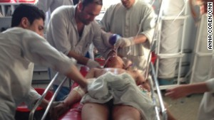 Doctors work to save a young landmine victim.