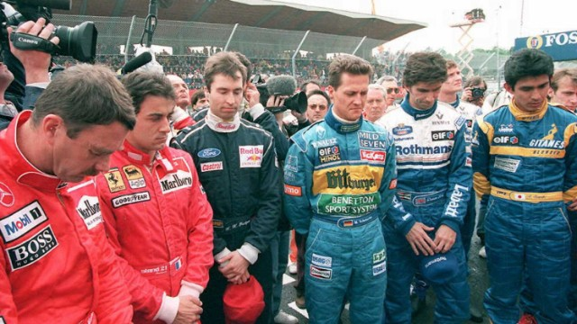 F1 drivers paid tribute to both Senna and Ratzenberger following the double tragedy. Left to right -- Britain's Nigel Mansell, Jean Alesi of France, Germany's Heinz-Harald Frentzen and Michael Schumacher, Briton Damon Hill and Aguri Suzuki of Japan.