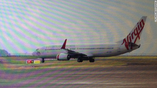 This photo, taken through a plane window, shows the Virgin Australia aircraft at Bali airport, Denpasar on April 25, 2014.
