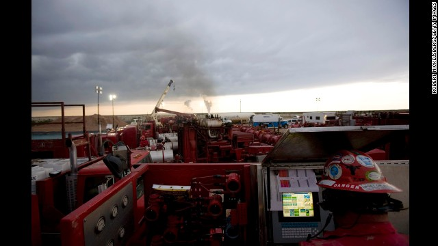 A Halliburton employee monitors a fracking operation outside Hope, New Mexico, in 2007. Fracking, or hydraulic fracturing, is the process of breaking through dense shale to unlock natural gas.