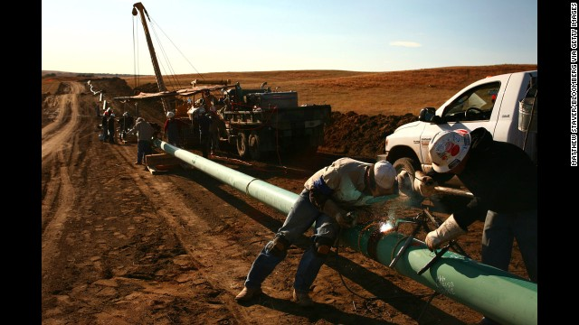 A crew constructs a 10-inch gas pipeline outside Watford City, North Dakota. In fracking, water, sand and chemicals are injected under high pressure into a gas well.