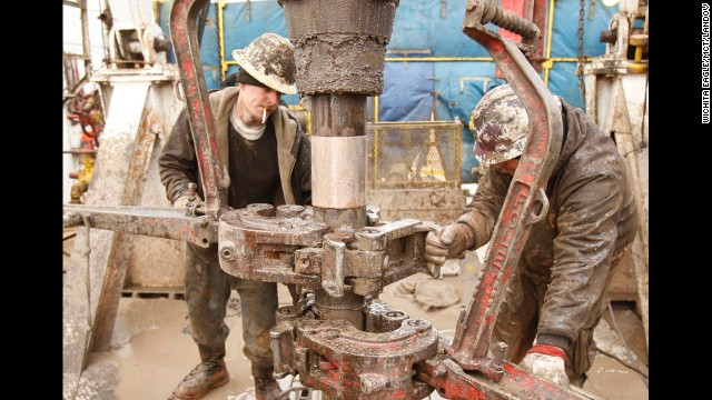 Rig workers drill a saltwater well to get fluids to be used in a fracking operation in Anthony, Kansas, in 2012.