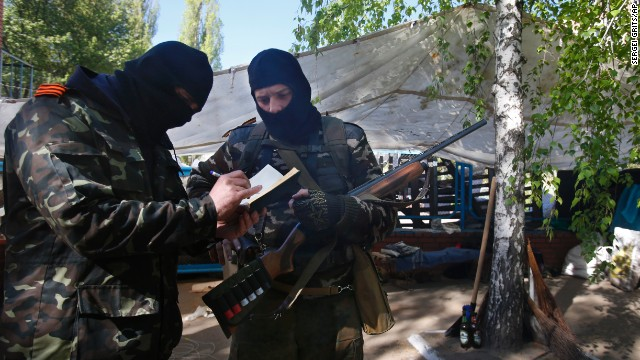 Pro-Russian militants keep records of their duty at the barricades in Slavyansk, eastern Ukraine, April 25.