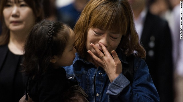 People in Ansan attend a memorial for the