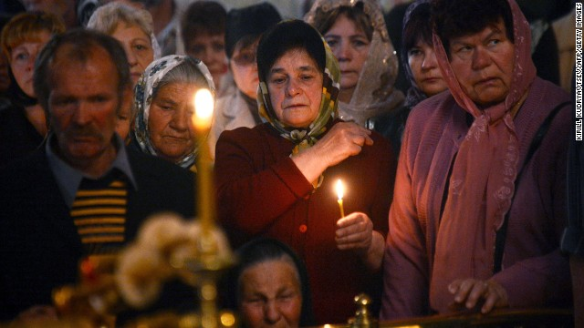Relatives and friends of a man killed in a gunfight participate in his funeral ceremony in the eastern Ukrainian city of Slavyansk on Saturday, April 26. Ukraine has seen a sharp rise in tensions since a new pro-European government took charge of the country in February.