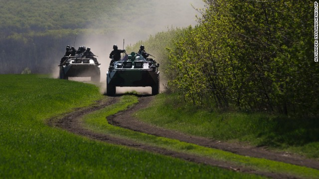 Ukrainian government troops in armored personal carriers travel on a country road outside the town of Svyitohirsk near Slavyansk in eastern Ukraine on April 26. Two tortured bodies have been found near Slavyansk, one of which was pro-Kiev politician Vladimir Rybak, who Ukraine's Interior Ministry said Wednesday died as a result of injuries from torture and drowning.