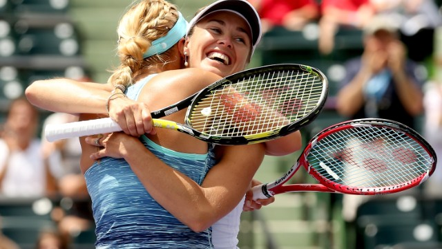 Time to flash her trademark smile as Hingis and Lisicki win the Sony Open in Miami in March. For Hingis, it is her first title in seven years.