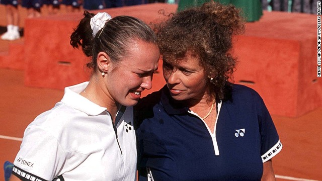 Hingis is comforted by her mom after losing a turbulent French Open in 1999 to Germany's Steffi Graf. The French is the only grand slam Hingis failed to win.
