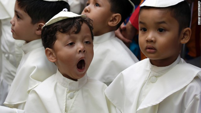 A boy dressed as a pope yawns as he joins a parade in Quezon, Philippines, on April 27 in celebration of the canonization of Pope John Paul II and Pope John XXIII.