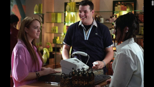 "Daniel Franzese (seen here with Lindsay Lohan and Lizzy Caplan) plays the witty sidekick Damian who was ""too gay to function."" Caplan plays Janis Ian, who is determined to take down the Plastics, aka the most popular girls in their high school."