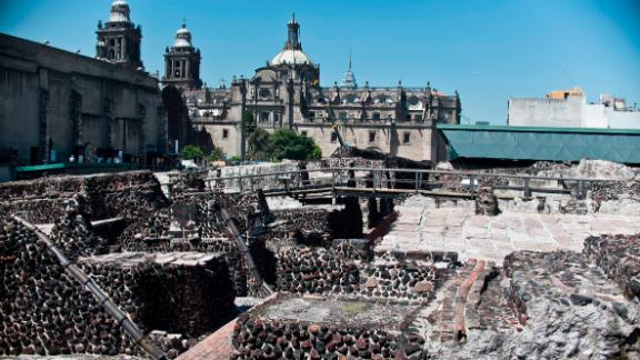General view of the Templo Mayor archaeological area in Mexico City, October 05 2012. A trunk of holm oak was found next to a set of 45 human skulls and a sacrifice stone in the archaeological area of the Greater Temple, it is estimated that the skulls are 500 years old and the piece of oak could be one of the sacred trees of the ceremonial area of Tenochtitl·n according to archaeologists. The Templo Mayor was the center of the religious life of the Aztecs in their capital city of Tenochtitlan, which is now Mexico City. AFP PHOTO/RONALDO SCHEMIDT (Photo credit should read Ronaldo Schemidt/AFP/Getty Images)