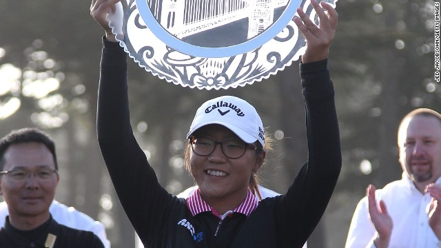 Ko lifts her third trophy on the LPGA Tour after victory in the 2014 Swinging Skirts Classic in California.