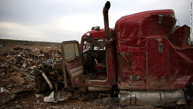 The remains of a large truck rest amid debris in Vilonia on April 29.