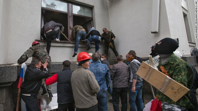 Pro-Russian activists storm an administration building in the center of Luhansk on Tuesday, April 29.