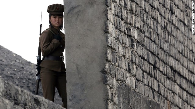 A North Korean soldier patrols the bank of the Yalu River, which separates the North Korean town of Sinuiju from the Chinese border town of Dandong, on April 26.