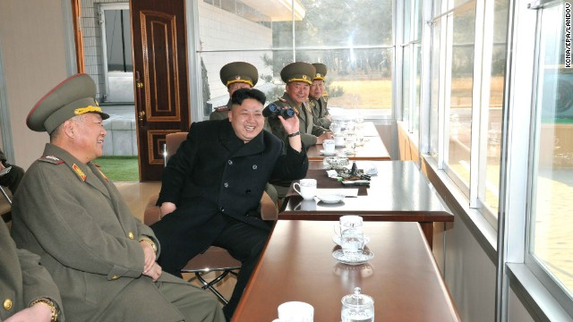 A picture released Tuesday, March 18, by the KCNA shows Kim attending a shooting practice at a military academy in Pyongyang.