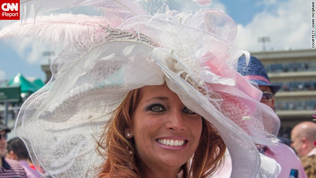 """""""This is a classic photo of the time and money that goes into picking a hat,"""" McGraw says. """"Many people don't even see the horses race. They are there to be seen or people-watch."""""""