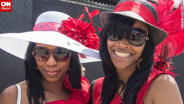"Big glasses, big hats and big smiles. The derby is also referred to as ""The Run for the Roses"" for the <a href='http://www.cnn.com/2014/05/01/sport/kentucky-derby-weather-story/'>garland of 554 red roses</a> draped over the winner."