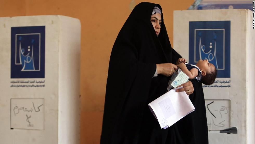 APRIL 30 - BASRA, IRAQ: A woman prepares to cast her vote for the parliamentary elections. <a href='http://cnn.com/2014/04/30/world/meast/iraq-elections/index.html'>Iraq is holding its third poll</a> since the 2003 U.S.-led invasion that toppled dictator Saddam Hussein. 21.5 million voters are eligible to cast their ballots. More than 9,000 candidates are vying to fill 328 seats.
