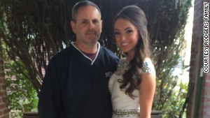 Senior Abby Rodgers, here with her father, went without a date to St. Basil Academy\'s prom in suburban Philadelphia.