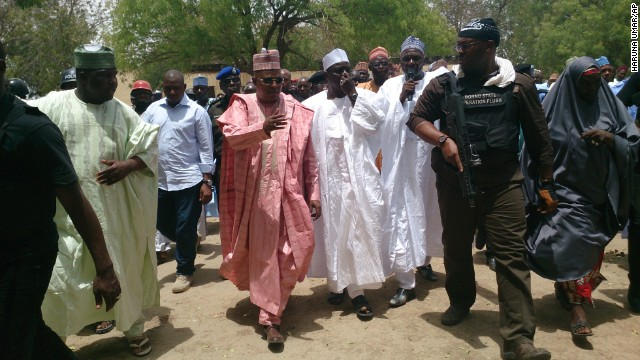 Borno state governor Kashim Shettima, center, visits the Chibok school on April 21.