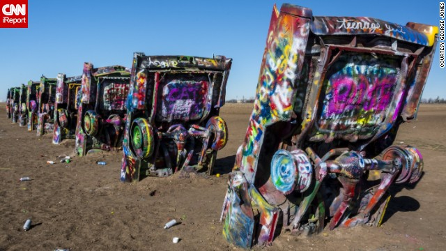 <a href='http://ireport.cnn.com/docs/DOC-1068230'>Cadillac Ranch</a>, located just west of Amarillo, Texas, on the south side of Interstate 40, was built by an artist collective in 1974. Motorists stop daily to gawk or spray messages on the 10 half-buried vintage cars.
