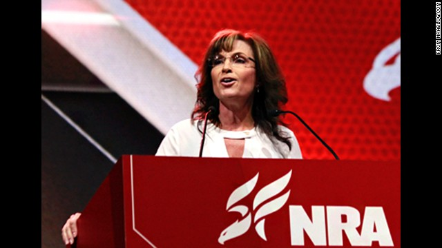 "In this photo from the NRA's blog, Sarah Palin addresses the crowd at the 2014 National Rifle Association's annual meeting on Saturday, April 26. She shocked both liberal and conservative commentators when she said, ""Well, if I were in charge, they would know that waterboarding is how we baptize terrorists."""