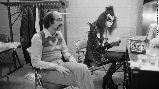 Gene Simmons, KISS' long-tongued bassist and vocalist, sits backstage in Detroit with Larry Harris in May 1975. Harris co-founded Casablanca Records, KISS' record label.