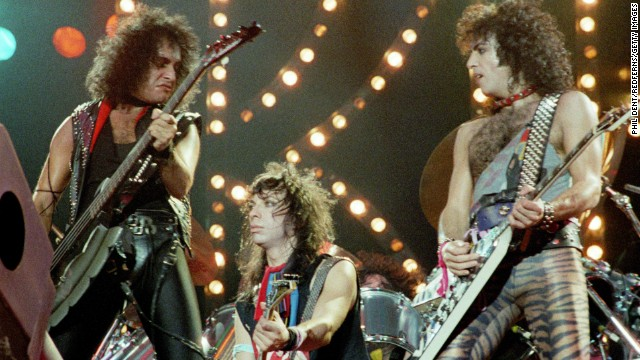 "In late 1983, the band decided to go without its famous makeup, first in an appearance on MTV and then on tour. Simmons had trouble coping. ""(I) didn't know how I was supposed to act, because the non-makeup version of the band was an entirely new idea,"" he wrote in his book, ""Kiss and Make-Up."" Left to right, Simmons, Vincent and Stanley play London's Wembley Arena in 1983."