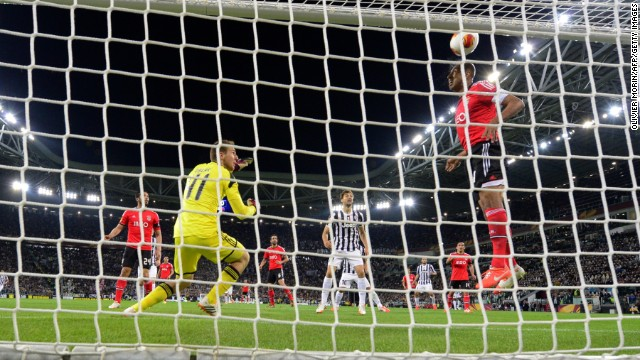Veteran Benfica defender Luisao clears Arturo Vidal's header off the line to keep the score at 0-0 as Juve pushed hard for the goal they needed.