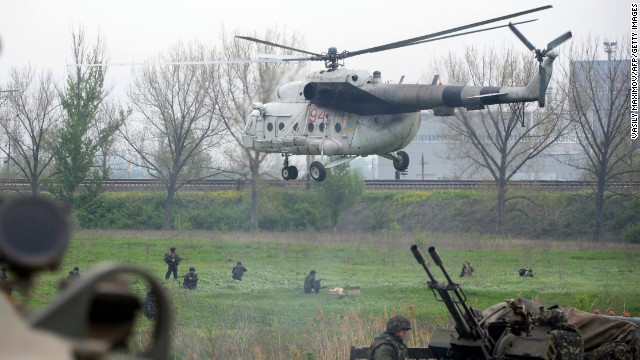 Ukrainian soldiers arrive to reinforce a checkpoint that troops seized Friday, May 2, in Andreevka, a village near Slovyansk. Two helicopters were downed Friday as Ukrainian security forces tried to dislodge pro-Russian separatists from Slovyansk, Ukraine's Defense Ministry said.